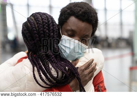 Black Couple Met In Airport After Separation Due To Covid Lockdown. Romantic Man In Mask Woman Give