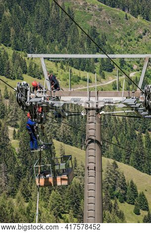 maintenance work on a cable car support