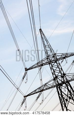 electricity pylons against the sky