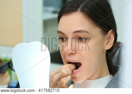 Woman In Dentistry Removes Silicone Invisible Transparent Teeth Trainer From Her Mouth By Herself Lo