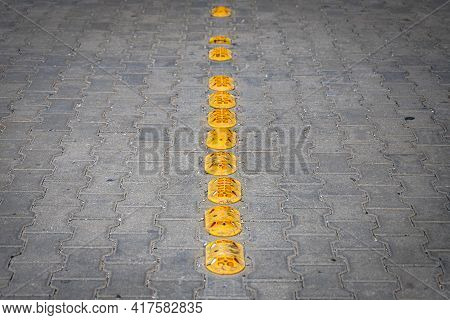 Road Bumps For Reduce Speed. Small Rubber Bumps On The Sidewalk Road