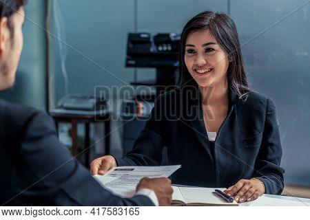 Human Resource Manager Interviewing The Male Employment Candidate In The Office Room. Happy Job Inte