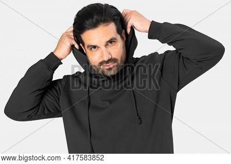 Indian man wearing basic black hoodie close-up