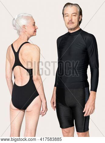 Senior woman and man in swimsuits summer apparel full body