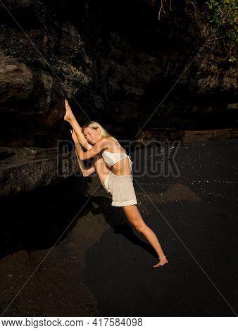 Yoga Practice. Beautiful Caucasian Woman Practicing Samsahate Hanumanasana, Standing Split Pose. Ham