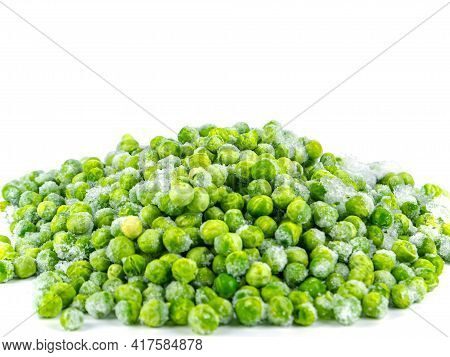 Frozen Green Peas Vegetable On A White Plate. Frozen Vegetables. Green Peas. Food In The Refrigerato