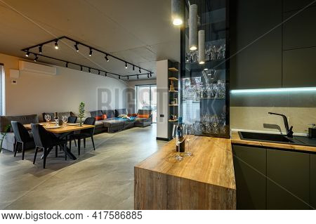 Modern luxury loft studio apartment interior with dining table in large living room