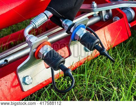 Hydraulics Hhose Inlets Plugs With Black Caps Found On Farm Equipment.