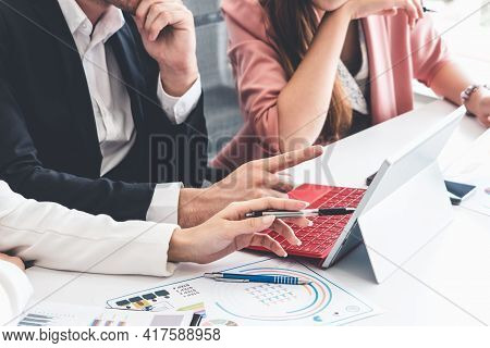 Businessman Is In Meeting Discussion With Colleague Businesswomen In Modern Workplace Office. People