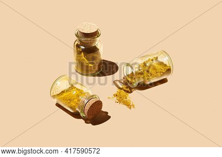 Three Glass Jars With Cork Lids Containing Curry Spice And Sprinkled Curry On Patel Yellow Seamless