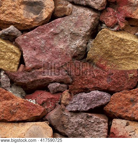 Seamless Texture. Background Of Red And Yellow Stones Of Different Shapes. Wall Of Stacked Stones.te