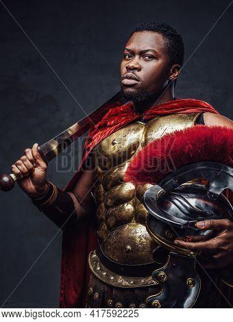 Proud Roman Warrior Of African Descent Holding Gladius On His Shoulder