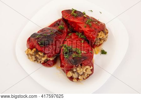 Red Peppers Stuffed With Meat And Rice. Filled Peppers In White Plate