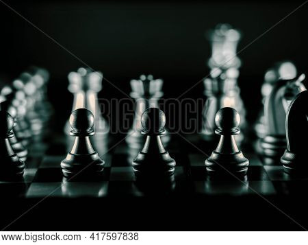 Chess Pieces On A Chessboard Business, Thinking, Strategy Concept. High Quality Photo