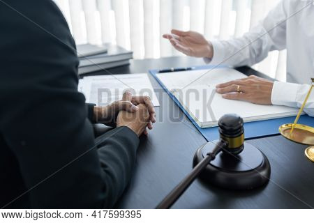 Law,libra Scale And Hammer On The Table, 2 Lawyers Are Discussing About Terms And Condition, Law Mat