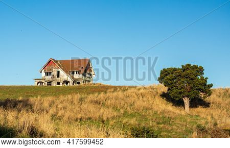 One Very Old Run Down House Up On A Hill.