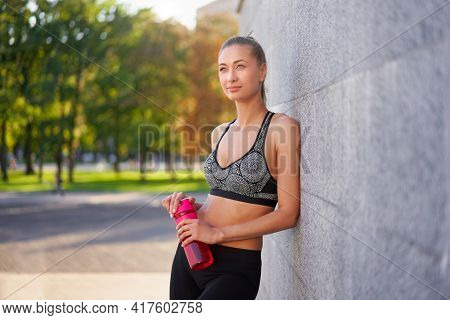 Tired Woman Drink Water After Morning Workout Young Athletic Female Standing Leaning Wall City Stree