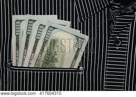 Money In Your Pocket. Banknotes Of 100 Dollars. Pocket Of Striped Shirt And American Money In It. Ca