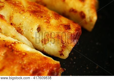 Pancakes Stuffed With Frying In A Frying Pan