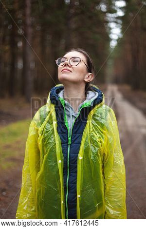 Young Woman Breathe Fresh Air In The Forest After The Rain, Rests, Relaxation, Standing In A Yellow