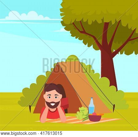 Happy Tourist Or Backpacker Lying In Tent. Male Character With Food And Drink In Tent In Forest