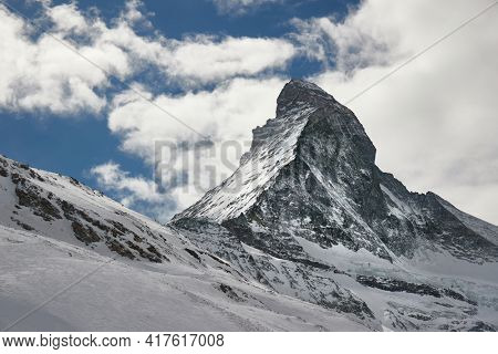 View of Matterhorn in the Swiss Alps, clouds behind the recognized natural landmark