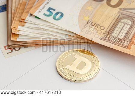 Dogecoin Coin And Euro Banknotes. Blockchain Money Versus Fiat Money Concept