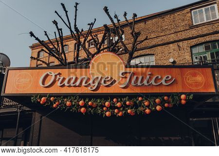 London, Uk - August 12, 2020: Sign On The Fresh Orange Juice Stall In Camden Market. Started With 16