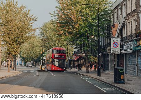 London, Uk - August 12, 2020: Modern Red Double Decker Bus On A Road In Camden, London. Iconic Red B