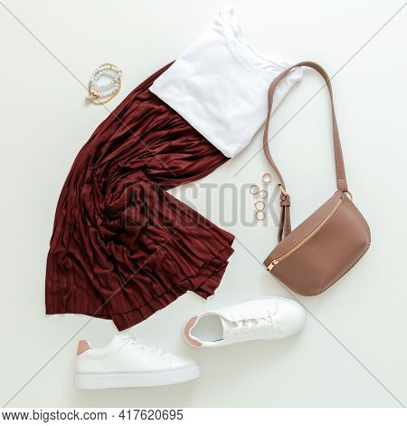 Female Spring Look Summer Outfit Burgundy Skirt White Shoes Sneakers White Basic Tshirt Waist Bag. F