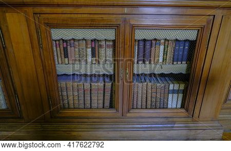 February 2021 Parma, Italy: Ancient Books On The Shelves Of Bookcase In The Biblioteca Palantina, Li