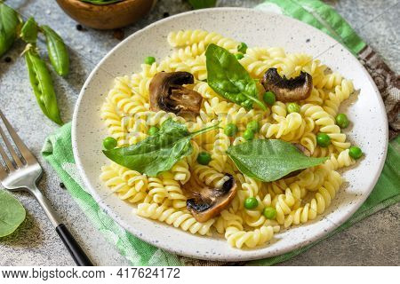 Healthy Eating. Pasta Fusilli With Mushrooms, Spinach And Green Peas On Stone Table. Vegetarian Vege
