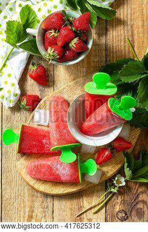 Summer Dessert. Homemade Strawberry Frozen Fruit Juice, Strawberry Ice Cream Or Strawberry Popsicles