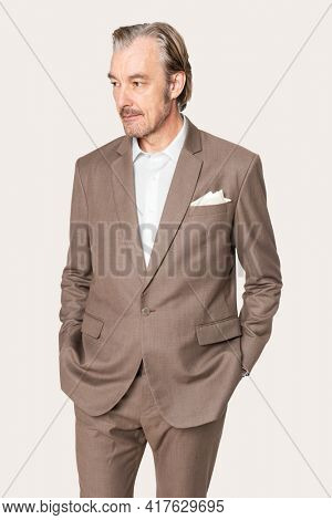 Businessman in brown suit studio portrait