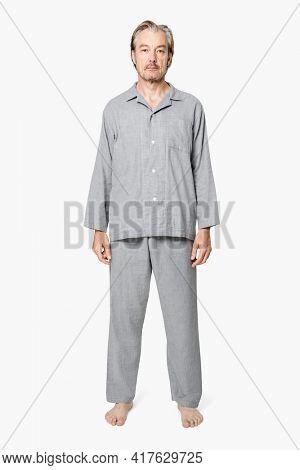 Senior man in gray pajamas nightwear apparel full body