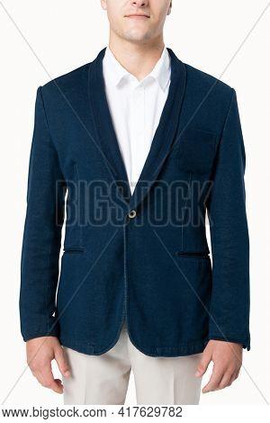 Businessman in navy suit for menswear apparel studio shoot