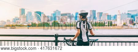Biking outdoor cyclist on bike path at Old Port of Montreal view cityscape panoramic banner. Woman on bicycle wearing helmet. Summer sports city lifestyle.