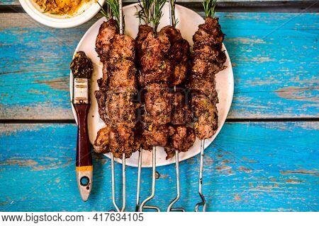 Pork Kebab With Rosemary Sauce.top Veiw.selective Focus