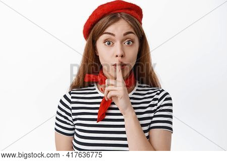 Close Up Of Cute Female Model In French Red Beret Hiding A Secret, Making Shh Shush Sign, Press Fing