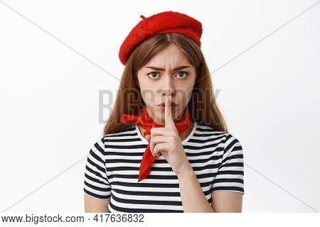 Angry And Bossy Girl In French Beret Scolding For Being Loud, Shushing, Making Shh Hush Gesture With