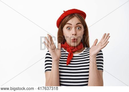 Close Up Of Excited And Surprised Girl Looks Amazed With Awesome Super Good News, Jumping From Excit
