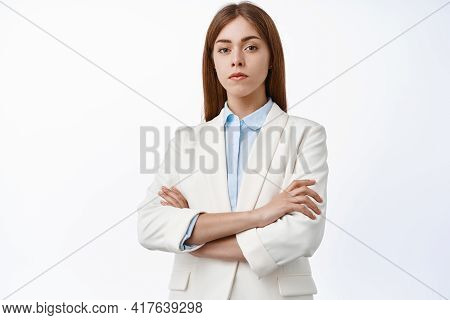 Serious And Confident Professional Woman In Business Suit, Cross Arms On Chest, Look Determined With