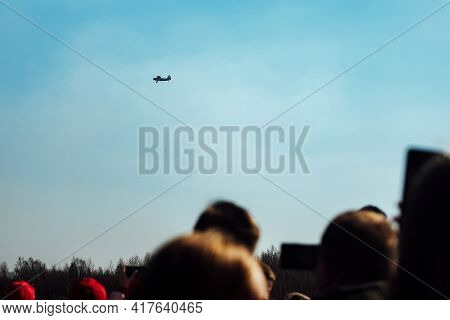 A Sports Plane Flies At Low Altitude Over The Audience Of The Air Festival. Spectacular Performance