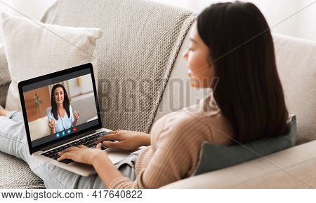 Online Tutoring Concept. Young Asian Female Having Virtual Lesson With Female Tutor