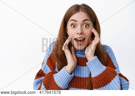 Close Up Of Excited Young Woman Gasping Amazed, Look With Excitement And Joy, Hear Positive Surprise
