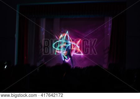 Light Show In Led Suits. The Artists On The Stage Dance Beautifully With Bright Multicolored Lightin