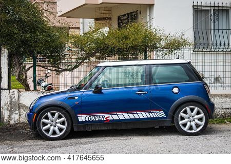 Antalya, Turkey - April 12 2021: Blue Mini Cooper S Parked On The Street On A Warm Summer Day Agains