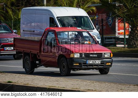 Antalya, Turkey - April 12 2021: Red Pickup Isuzu Campo Is Driving Fast On The Street On A Warm Summ