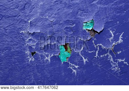 Peeling paint texture background, dark purple texture peeling paint.Texture background of peeling paint,purple peeling paint on the texture surface,close up of peeling paint texture on the texture background.Grunge texture surface with purple peeling pain