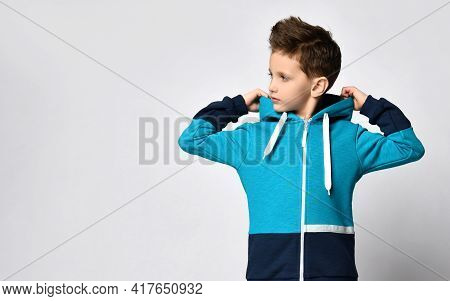 Half-length Portrait Of A Boy In A Sports Blue Hoodie With A Hood. Children Trendy Outfit Advertisin